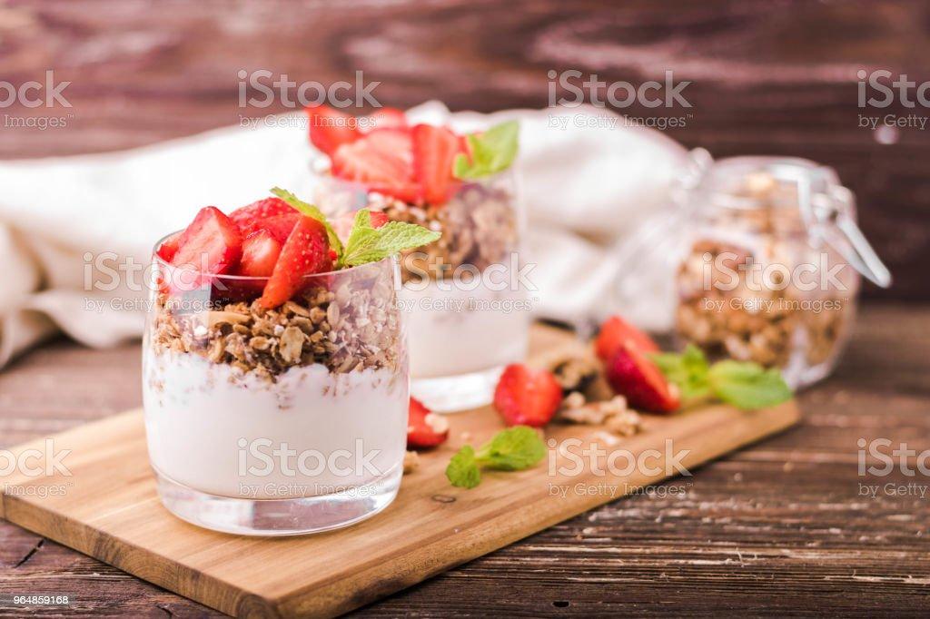 Yogurt parfait with strawberries royalty-free stock photo