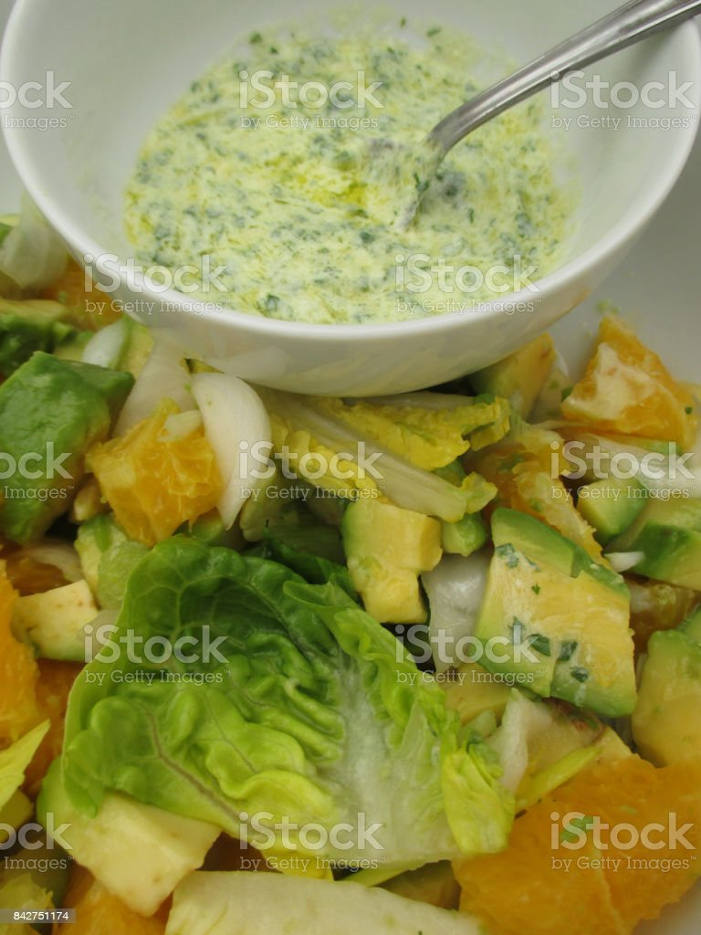 Yogurt sauce mixed salad with avocado orange white onion stock photo