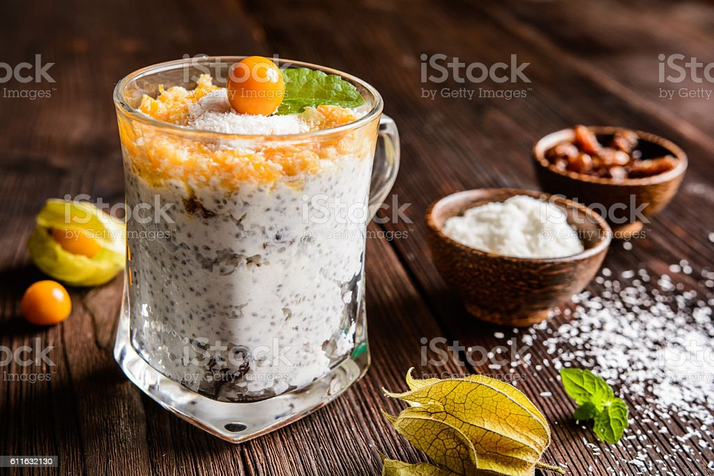 Yogurt with chia, coconut, honey and physalis puree stock photo