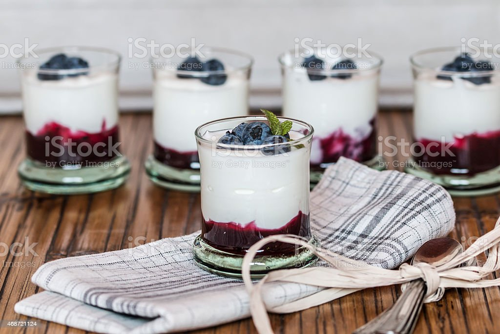 Yogurt with fresh blueberries and blueberries jam, in glass bowl stock photo