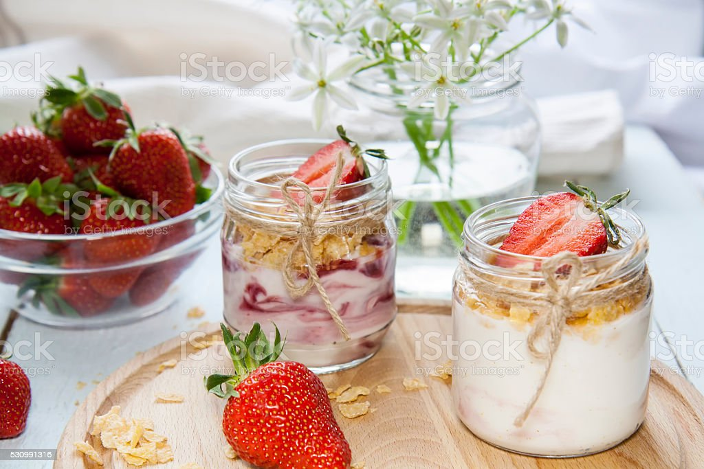 Yogurt with fresh strawberry and corn flakes royalty-free stock photo