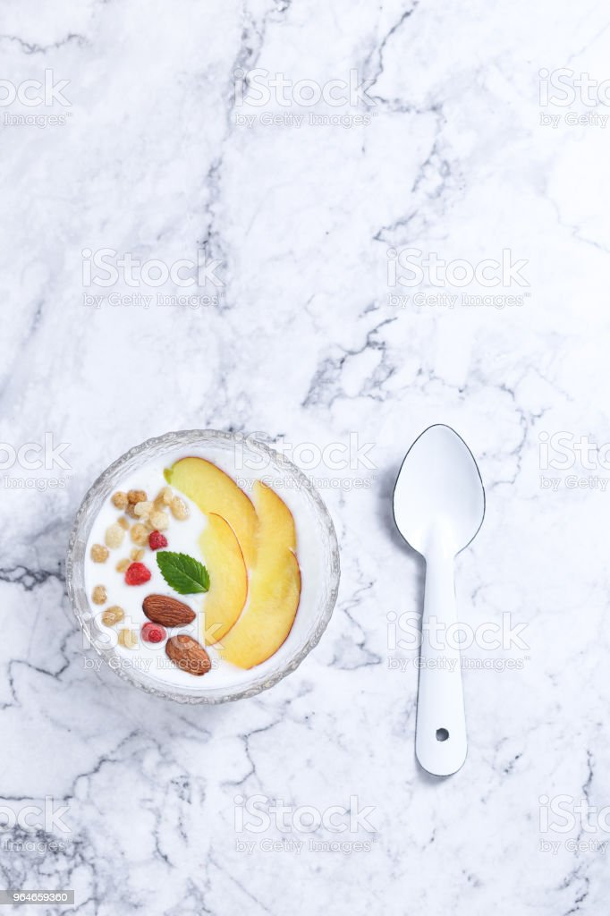 Yogurt with fruit and nuts royalty-free stock photo