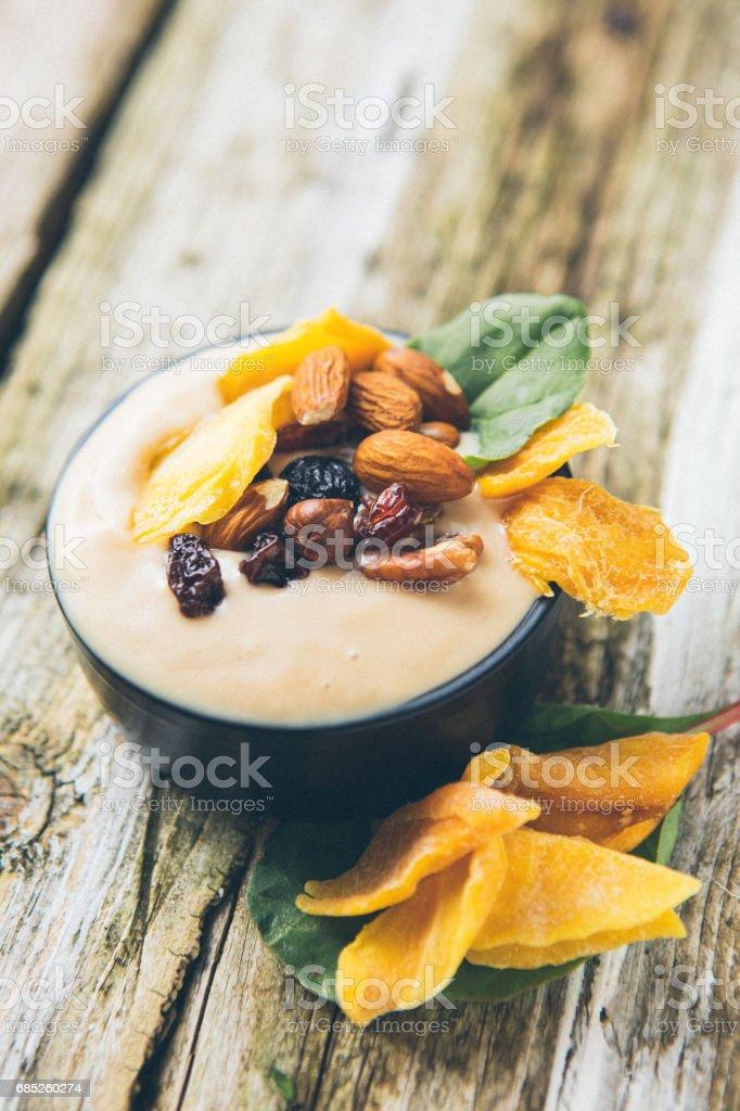 Yogurt with Mango and Nuts royalty-free stock photo