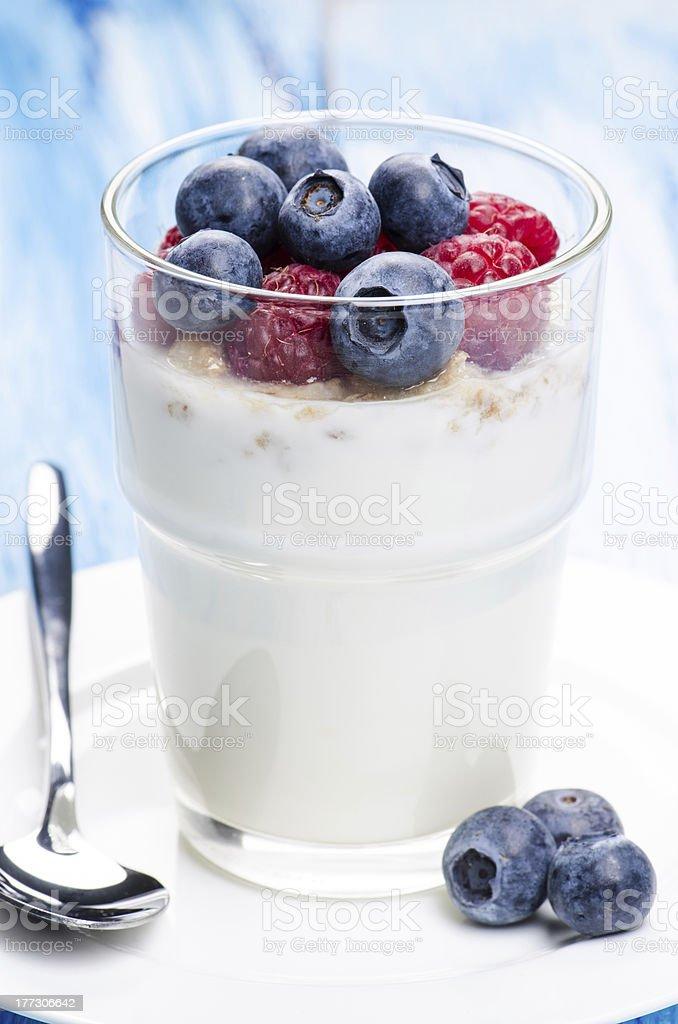 Yogurt with raspberries and blueberries royalty-free stock photo