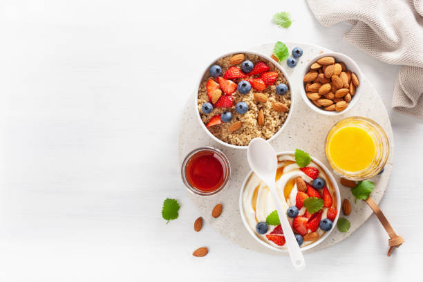 yogurt with strawberry blueberry honey almond and quinoa for breakfast yogurt with strawberry blueberry honey almond and quinoa for breakfast breakfast stock pictures, royalty-free photos & images