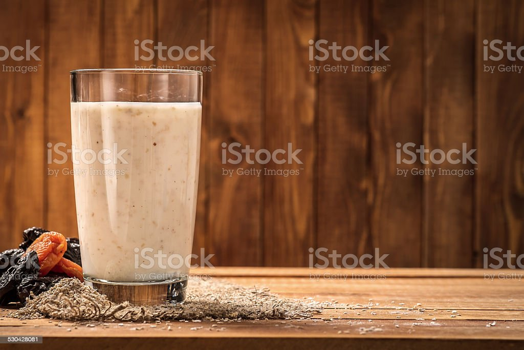 Yogurt with wheat bran as drink for improving the digestion stock photo
