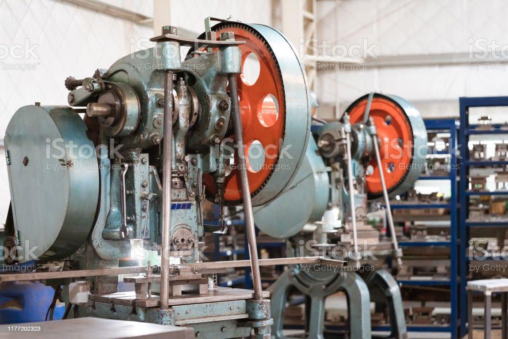 Yoke machine in metal factory Close-up of yoke machine. Manufacturing machinery is in factory. Absence Stock Photo