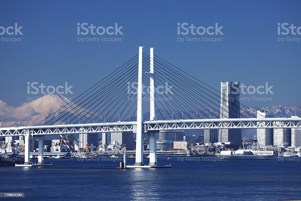 Yokohama Bay Bridge, Mt. Fuji, and a building stock photo