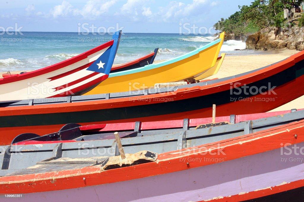 Yolas and Flag at Crash Boat Beach stock photo