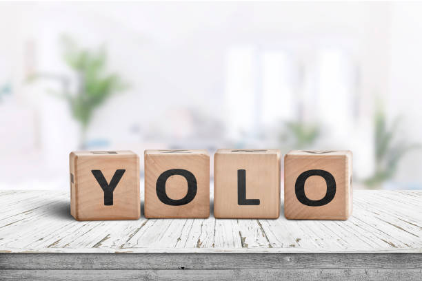 Yolo abbreviation sign in a bright living room stock photo
