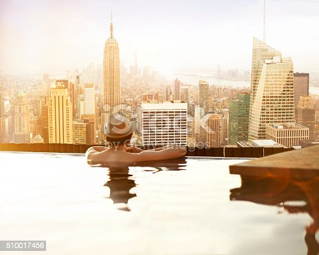 istock Yong man relaxing on hotel rooftop 510017456