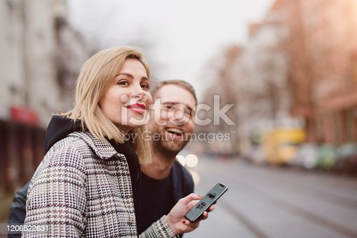 918377954 istock photo yong people looking out for a crowdsoourced taxi 1206822631
