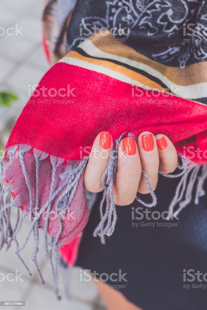 Yong woman hands with cashmere scarf. Bali island royalty-free stock photo