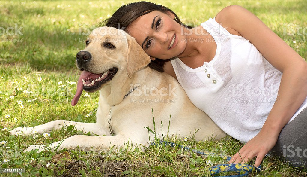 yong woman posing with her dog stock photo