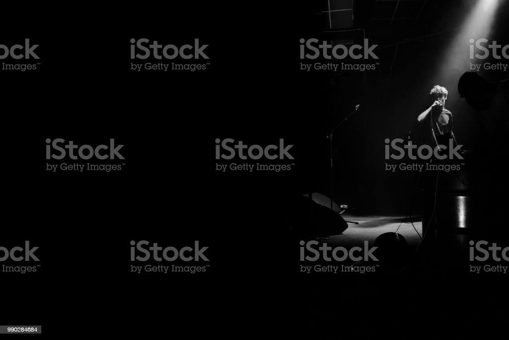 Yonung Rock Band In Action On Stage Stock Photo - Download