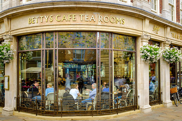 York Bettys Cafe Tea Rooms York, England - July 5, 2014: Betty's Cafe Tea Rooms, busy full of customers. At 6-8 St Helen€™s Square, York, North Yorkshire. tea room stock pictures, royalty-free photos & images