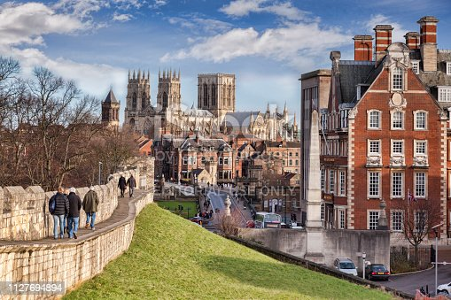 26 January 2015: York, North Yorkshire, England -  a view along the city wall towards York Minster, with tourists walking along the wall.