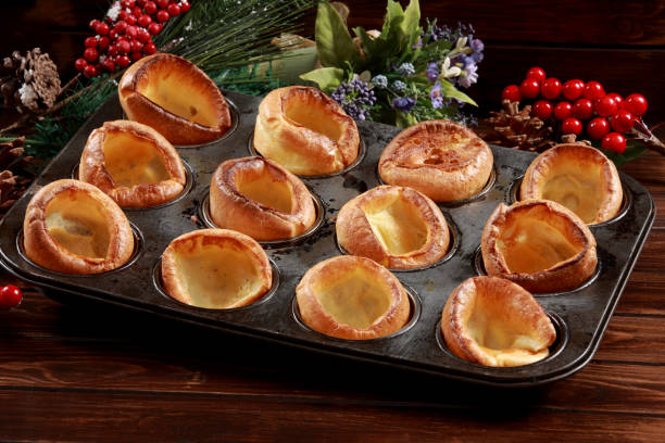Yorkshire Pudding Freshly baked Yorkshire Puddings to join a roast dinner. A classical and traditional use for main course lunch or dinner serving. Derived from English Cuisine muffin tin stock pictures, royalty-free photos & images