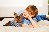 Happy mother with her son and cute Yorkshire Terrier together on white background