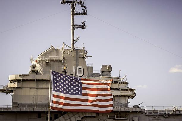USS Yorktown And American Flag stock photo