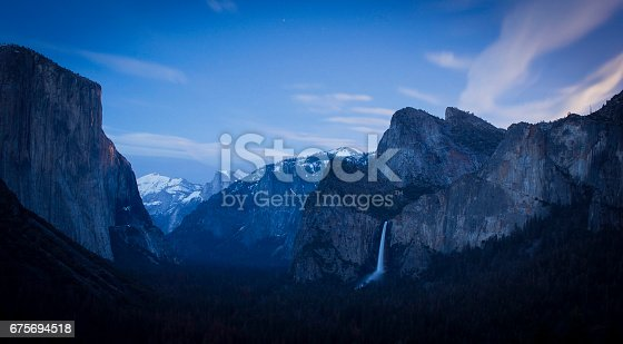 Classic view of Yosemite Valley lit by moonlight