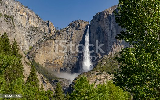 Yosemite Falls in Yosemite National Park California. A popular destination for viewing a magnificent waterfall. One of the most popular features at Yosemite Park. Lots of water due to spring runoff.