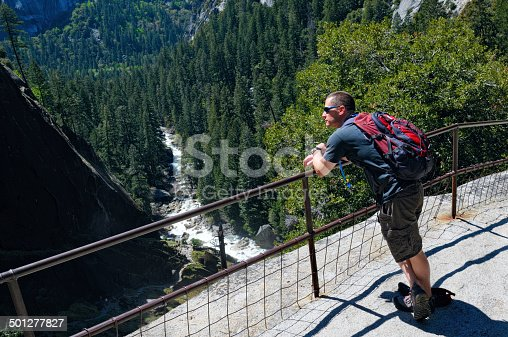 A male at the top of Vernal Falls after hiking the Mist Trail at Yosemite National Park.