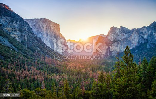 Classic Tunnel View of scenic Yosemite Valley with famous El Capitan and Half Dome rock climbing summits in beautiful golden morning light at sunrise in summer, Yosemite National Park, California, USA