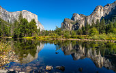 El Capitan, Half Dome, and Bridalveil Fall reflected on Merced river in Yosemite National Park. California. USA