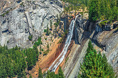 close up of Nevada Fall waterfall on Merced River from Mist Trail in Yosemite National Park. Summer travel holidays in California, United States of America.