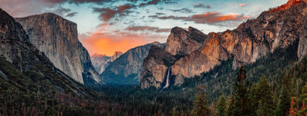 Yosemite Tunnel View at Sunset Yosemite Tunnel View Panorama at Sunset el capitan yosemite national park stock pictures, royalty-free photos & images
