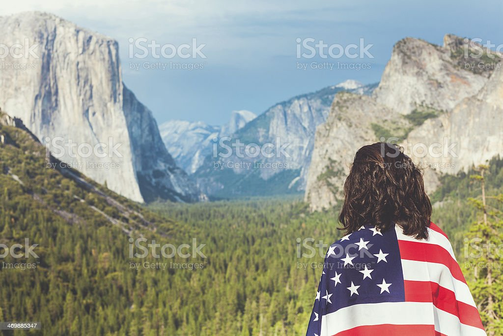 Yosemite Valley and Woman with American Flag stock photo