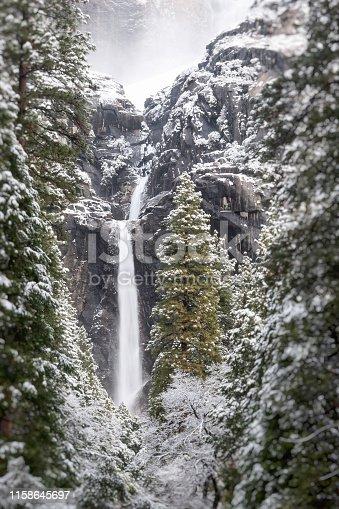A Yosemite waterfall in the fog.