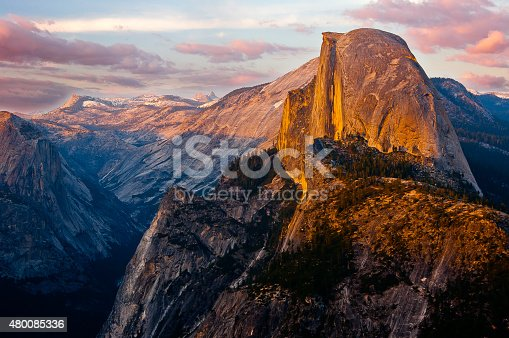 A brilliant sunset view of Half Dome from Glacier Point, a location that is only accessible via a strenuous hike, much of the year. Glacier Point give one of the best views of the Valley and several waterfalls including Vernal Falls, Nevada Falls, and Yosemite Falls.