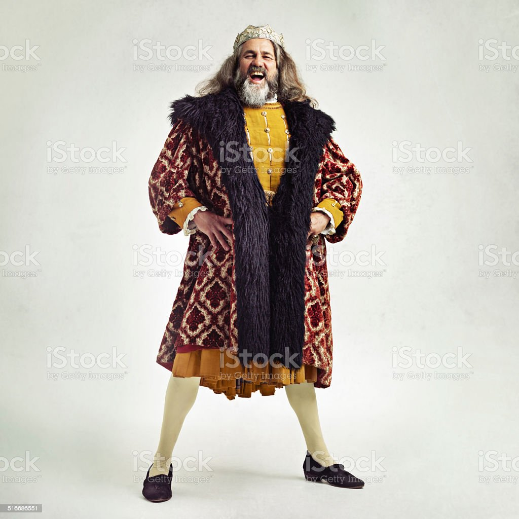 You amuse me good sire! Studio shot of a richly garbed king 17th Century Style Stock Photo