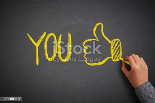 618753504 istock photo You and Thumb up 1022552192