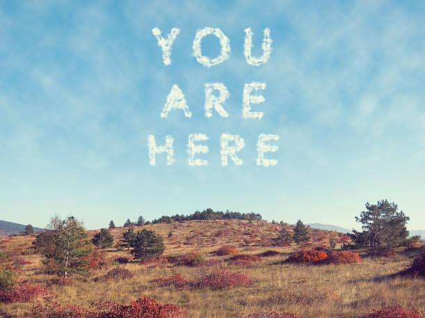 you are here skywriting on autumn hills of trieste - schrift am himmel stock-fotos und bilder