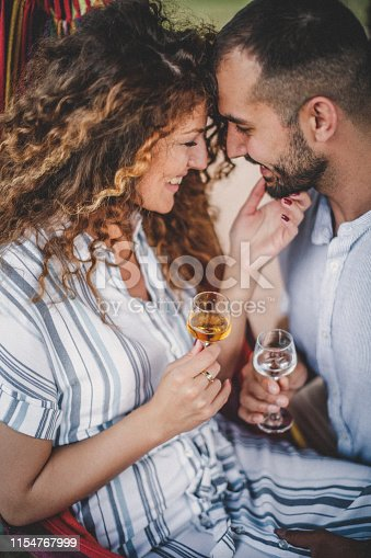 Lovely couple having having their moment with glass of brandy