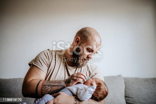 Father holding his newborn baby in arms