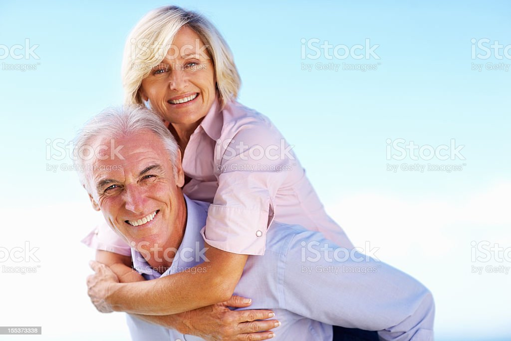 You are never too old for a piggyback royalty-free stock photo