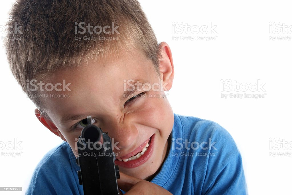 You boy in bright blue clothing with toy gun royalty-free stock photo