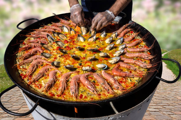 you can cook paella everywhere - paella stock photos and pictures