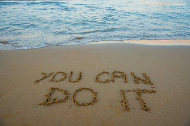 You can do it. Motivational inspirational message concept written on the sand of beach You can do it. Motivational inspirational message concept written on the sand of beach encouragement stock pictures, royalty-free photos & images