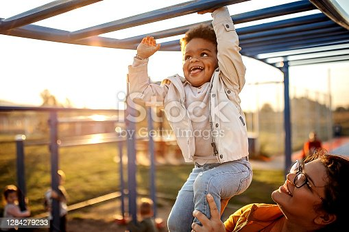 Kid playing with mother in public park