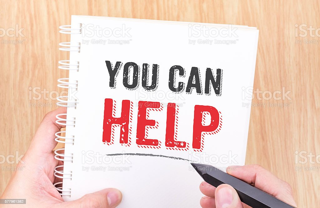You can help word on white ring binder notebook stock photo