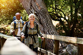 Shot of a senior couple enjoying themselves while out for a hike