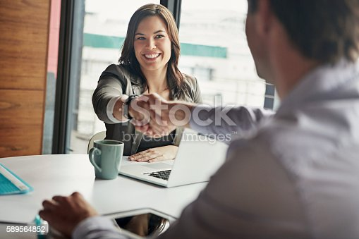 Shot of businesspeople at work together in a modern office