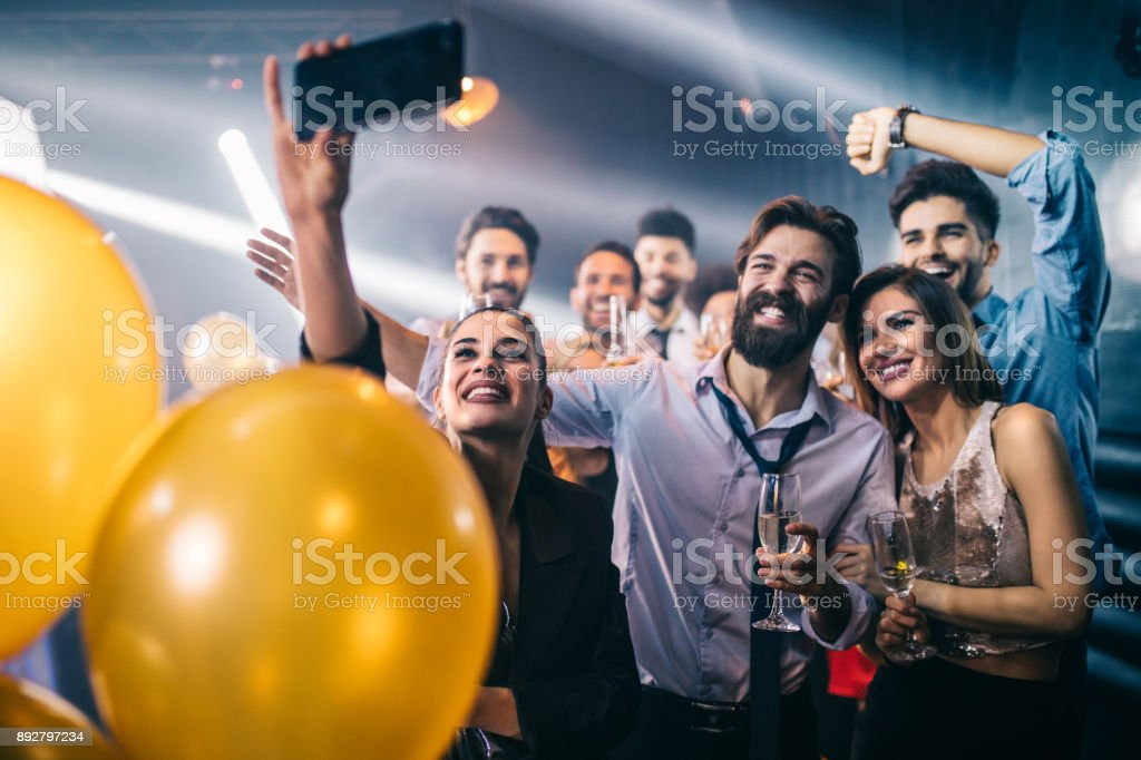 You can't have a party without taking a selfie stock photo