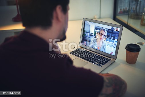 Shot of a mature psychologist conducting an online therapy session with her patient