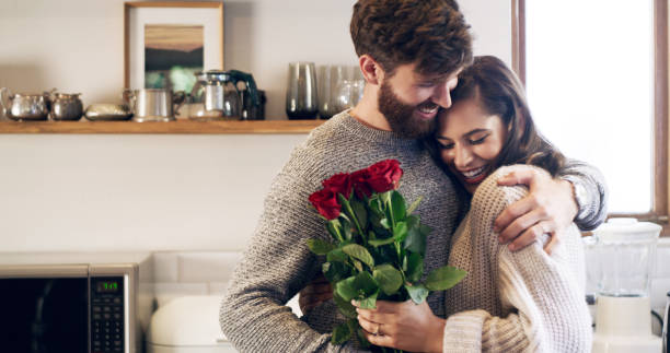 you don't need a reason to give her flowers - valentines day стоковые фото и изображения